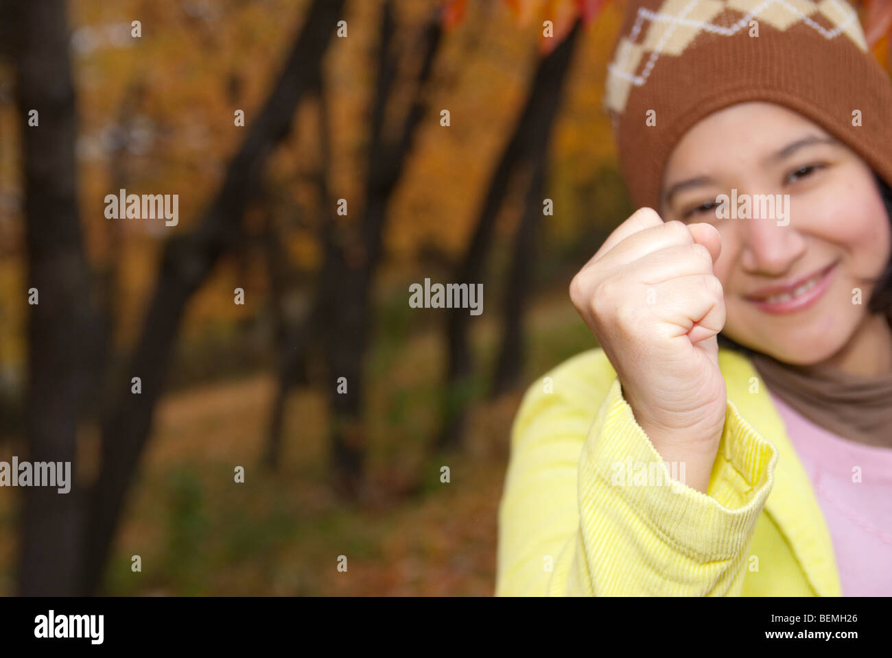 Autumn Weather young woman smiling - Stock Image