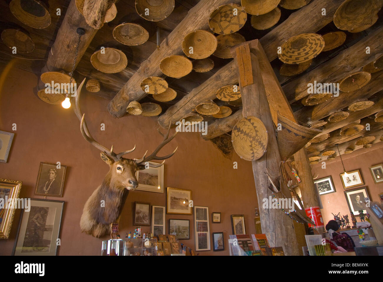 Elk Head, Indian baskets on ceiling at Hubbell Trading Post National Historic Site, Navajo Indian Reservation, Ganado, - Stock Image