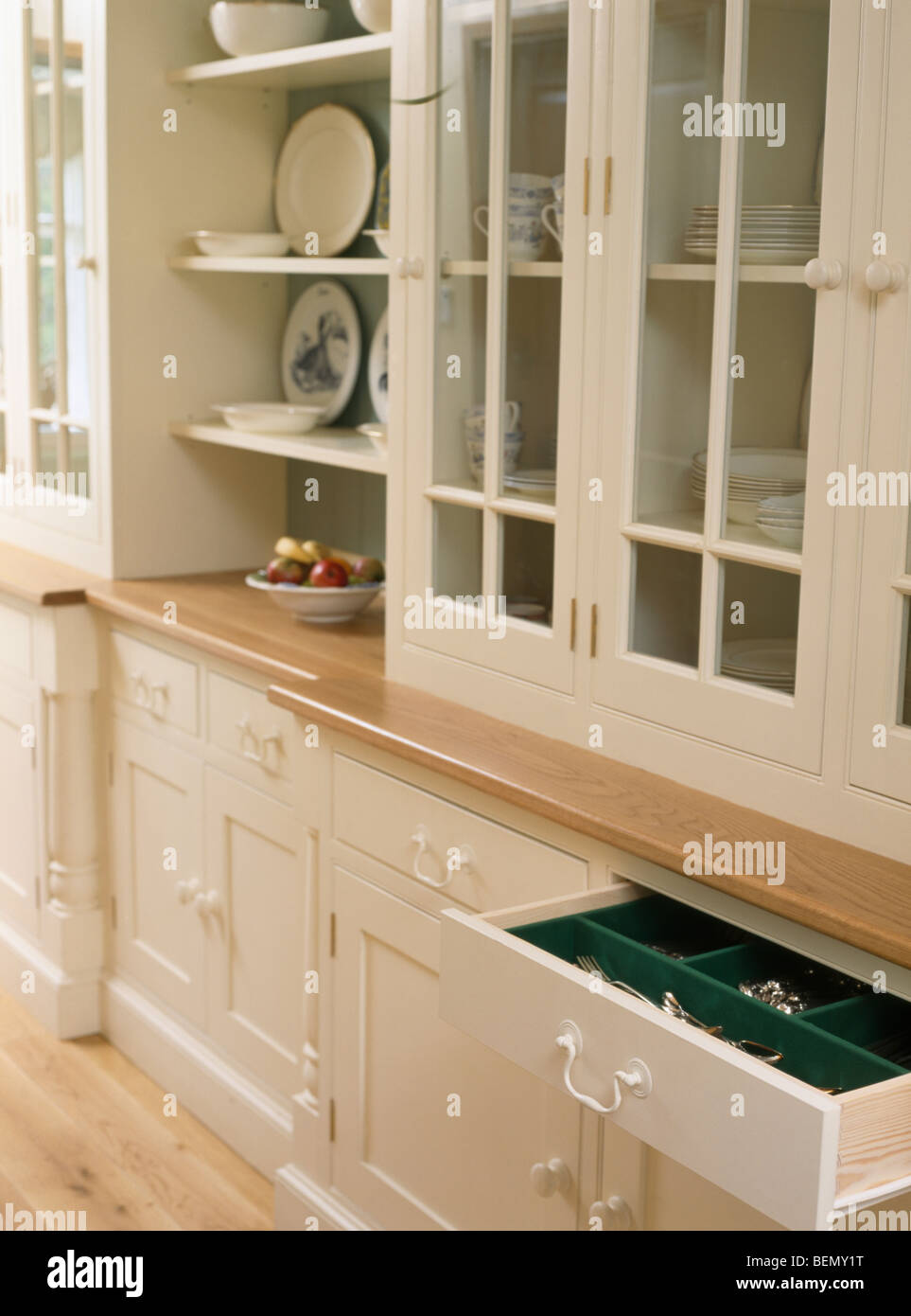 Close Up Of Cream Fitted Kitchen Cupboards With Glazed Doors Stock Photo Alamy