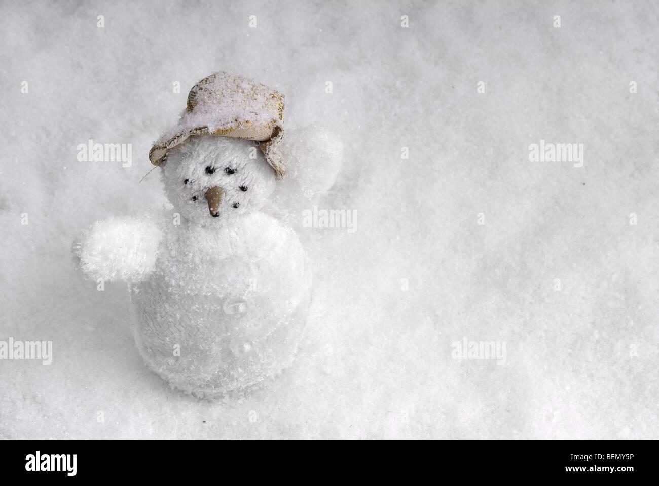 snowman in snow landscape - Stock Image