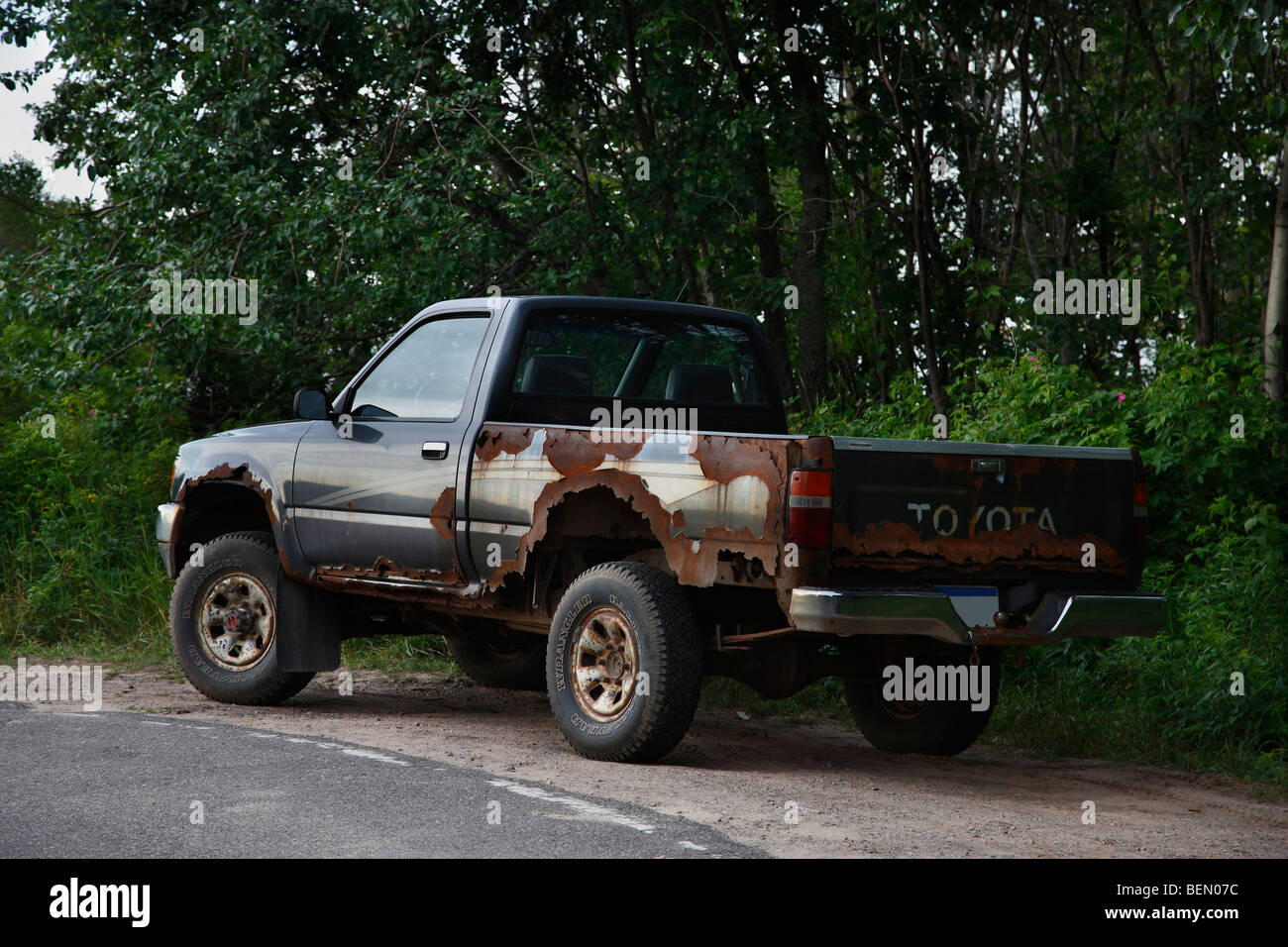 Old rusty junky Toyota pickup truck Stock Photo