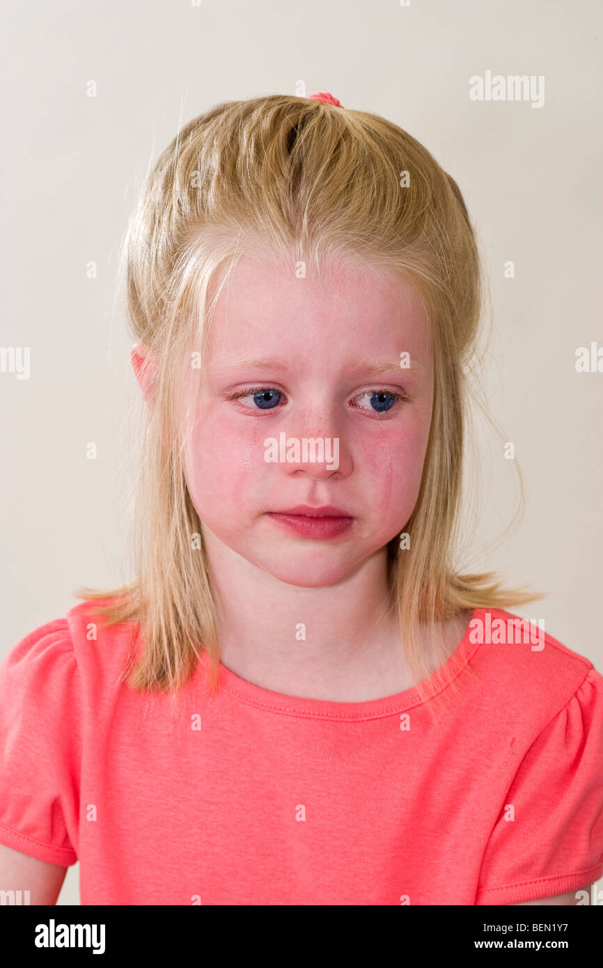 Closup young Caucasian 6 year old girl crying cries with ...