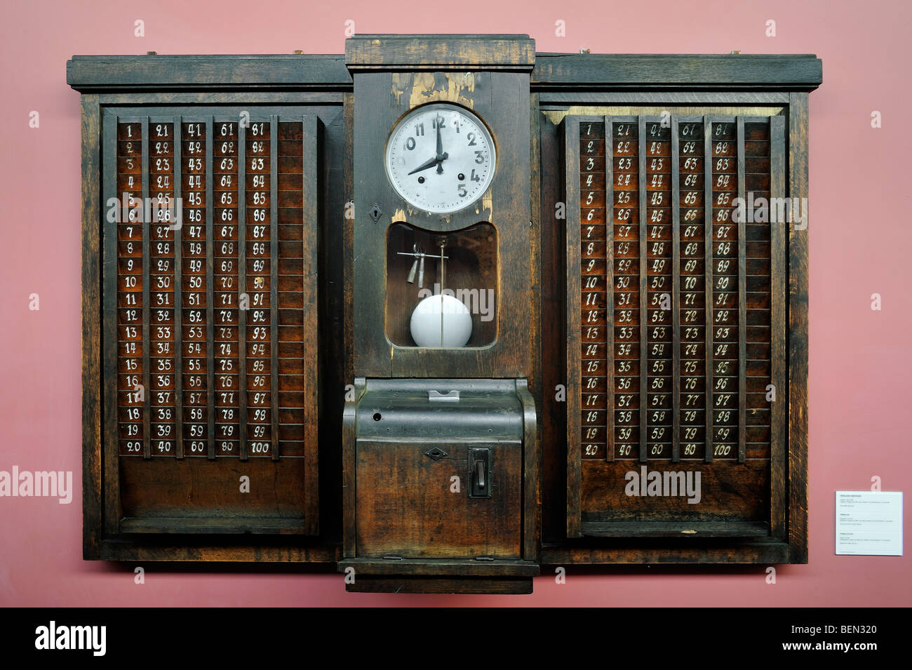 Antique time clock / punch clock at the Bois du Cazier coal mine museum, Marcinelle, Charleroi, Belgium Stock Photo