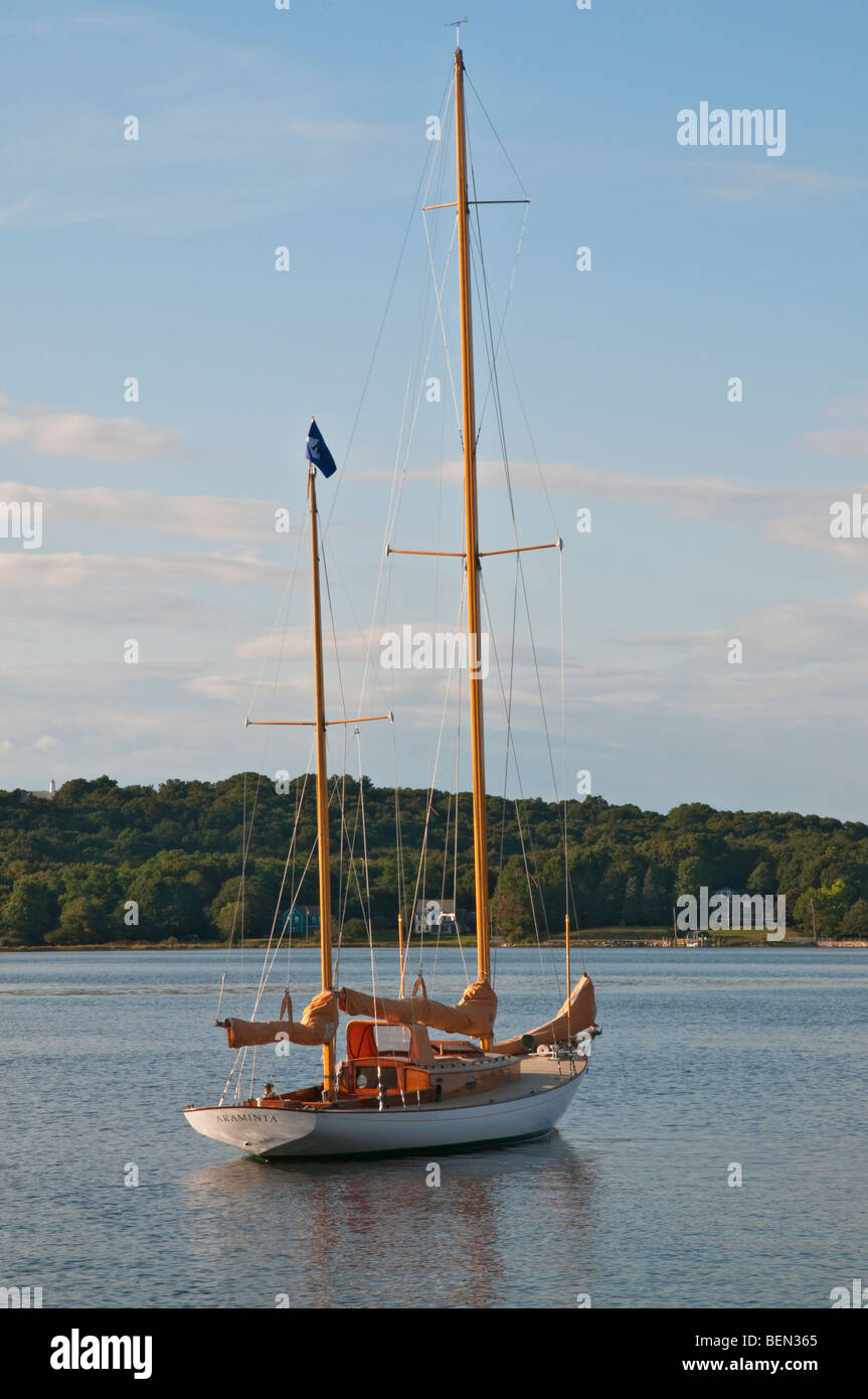 Connecticut Mystic River wooden classic sailboat Araminta - Herreshoff Auxiliary Ketch built 1954 on mooring - Stock Image