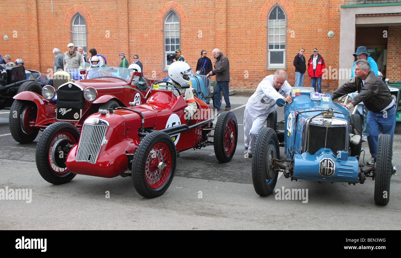 In the pit area - various classic and antique racing cars. - Stock Image