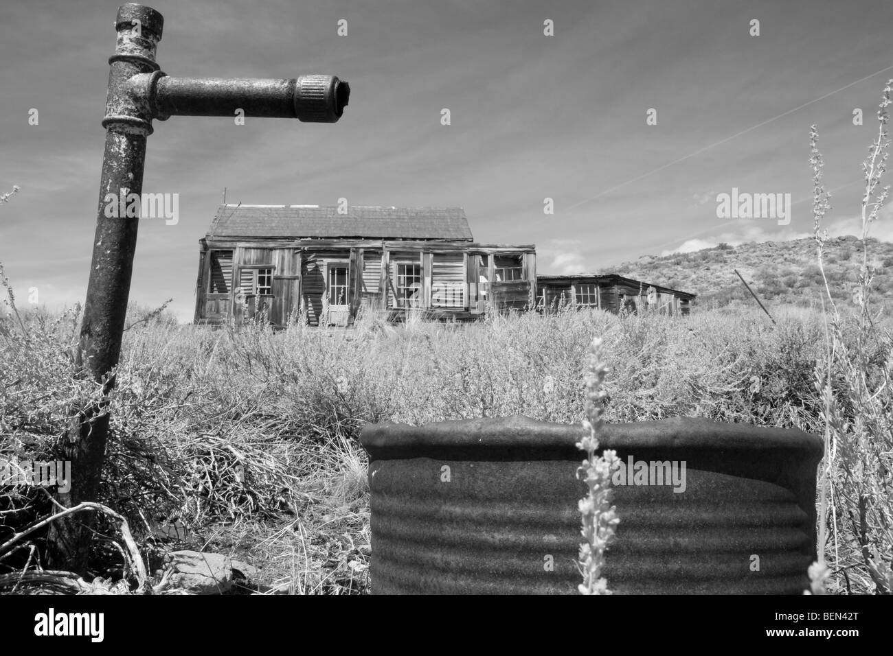 Dry well and spigot and abandoned homestead in the the ghost town of Bodie, CA - Stock Image
