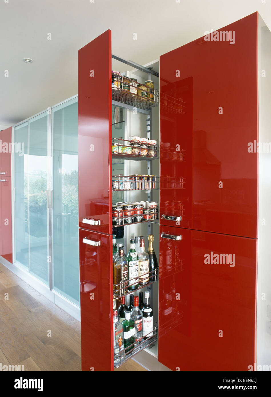 Pull Out Storage Shelves In Red Larder Cupboard In Modern Kitchen