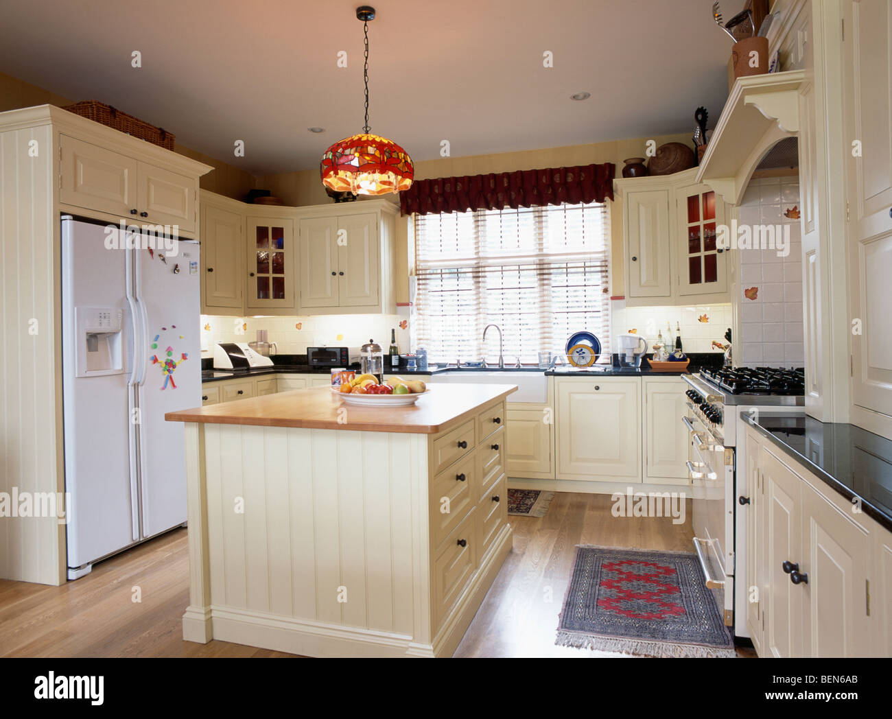 cream kitchen island cream island unit and fitted cupboards in country kitchen with large stock photo 26281539 alamy 6744