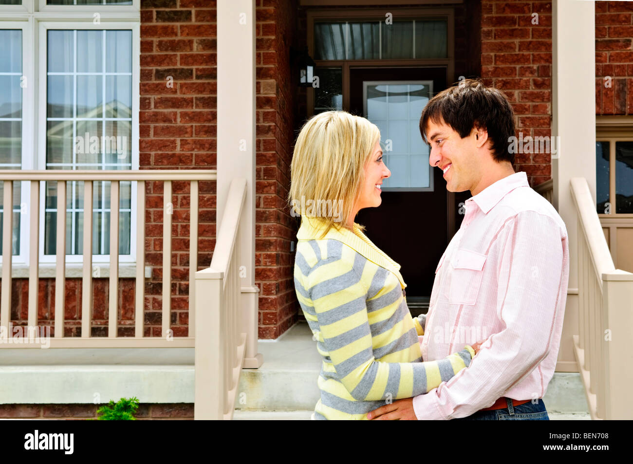 Young happy couple in love at home - Stock Image