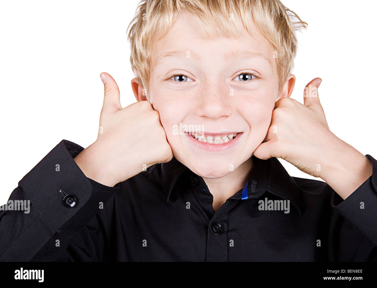 Isolated Shot of a Cute Blonde Haired Boy Smiling with Thumbs Up - Stock Image
