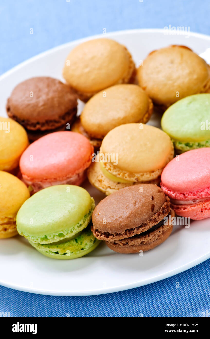 Fresh multicolored macaroon cookies served on a plate - Stock Image