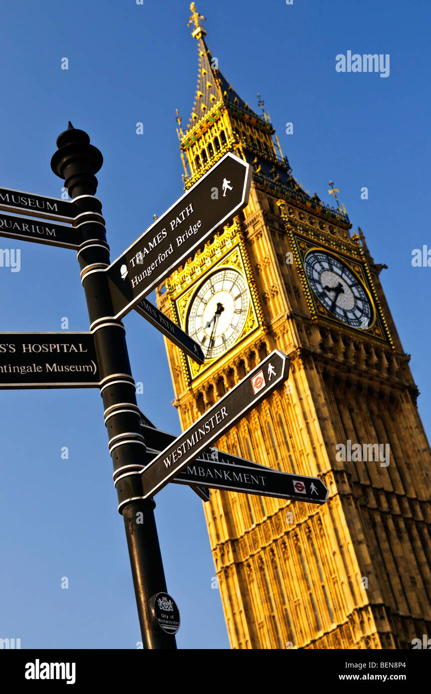 Big Ben clock tower with signpost in London - Stock Image