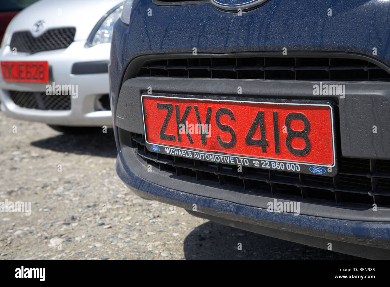 red number plates indicating hire cars in the republic of cyprus europe - Stock Image