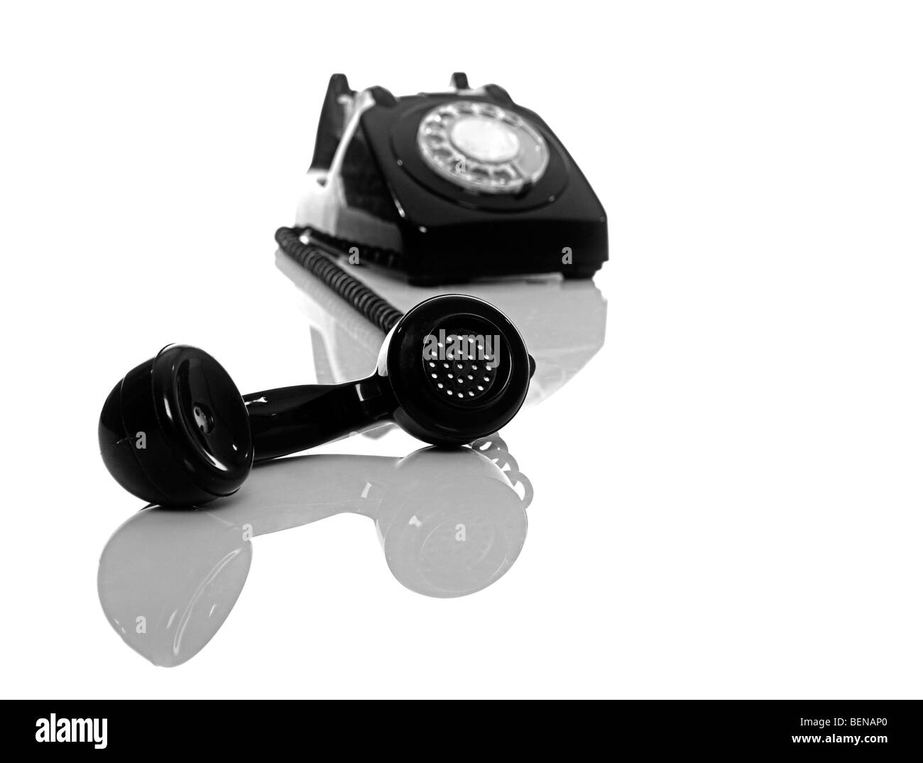 Vintage phone on a white background with reflection - Stock Image