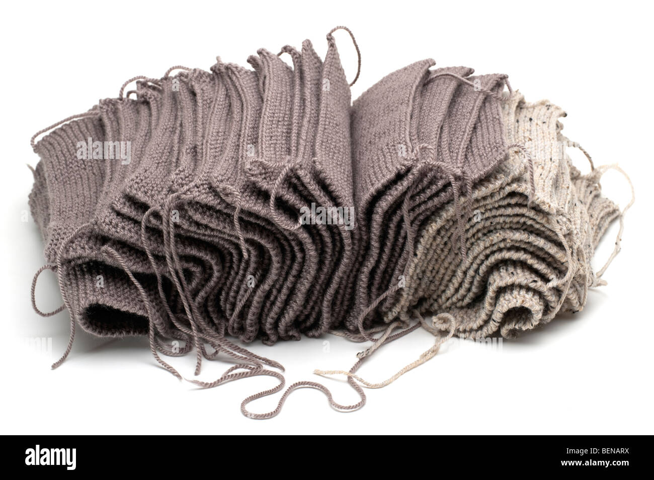 Pile of brown and beige knitted wool squares - Stock Image