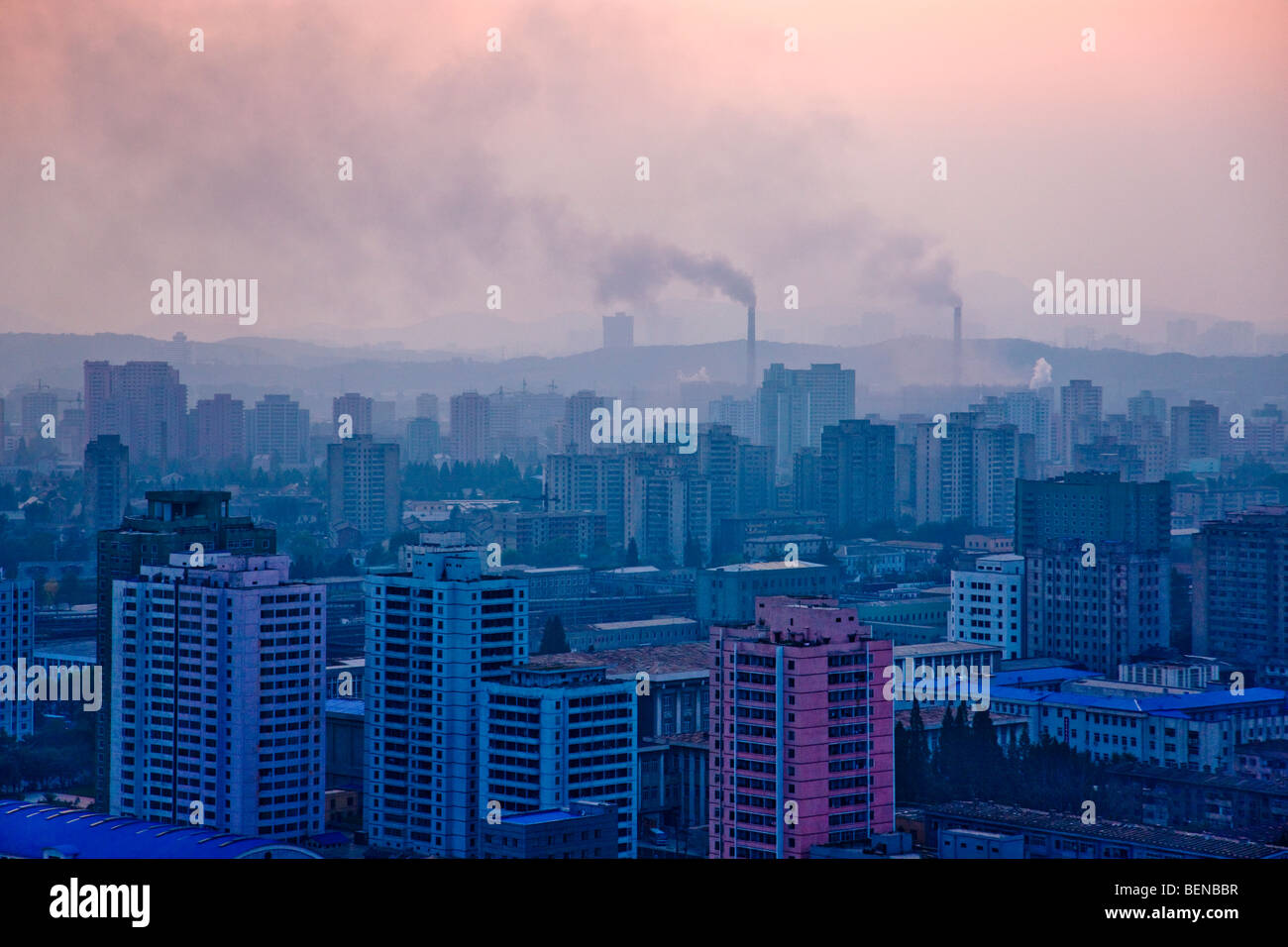 Cityscape, chimney pollution in the distance, Pyongyang, North Korea - Stock Image