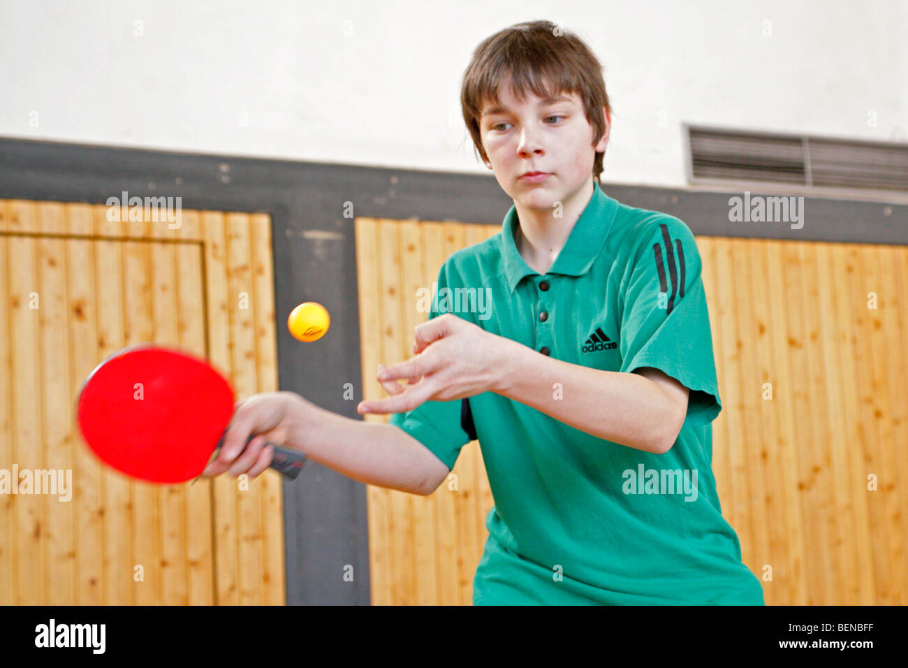 young boy playing table tennis Stock Photo - Alamy