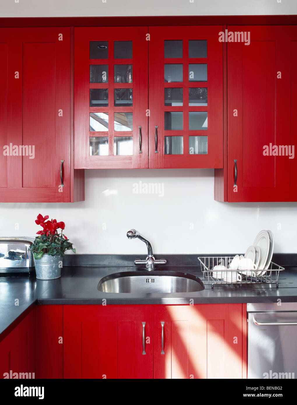 Red Wall Cupboard With Glazed Doors Above Under Set Sink In Modern Stock Photo Alamy