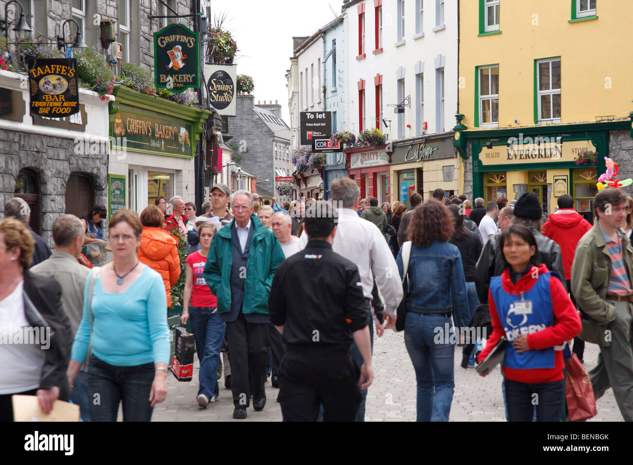 many people on shopping mile in the city centre (High Street - Latin Quarter) of Galway, Ireland - Stock Image