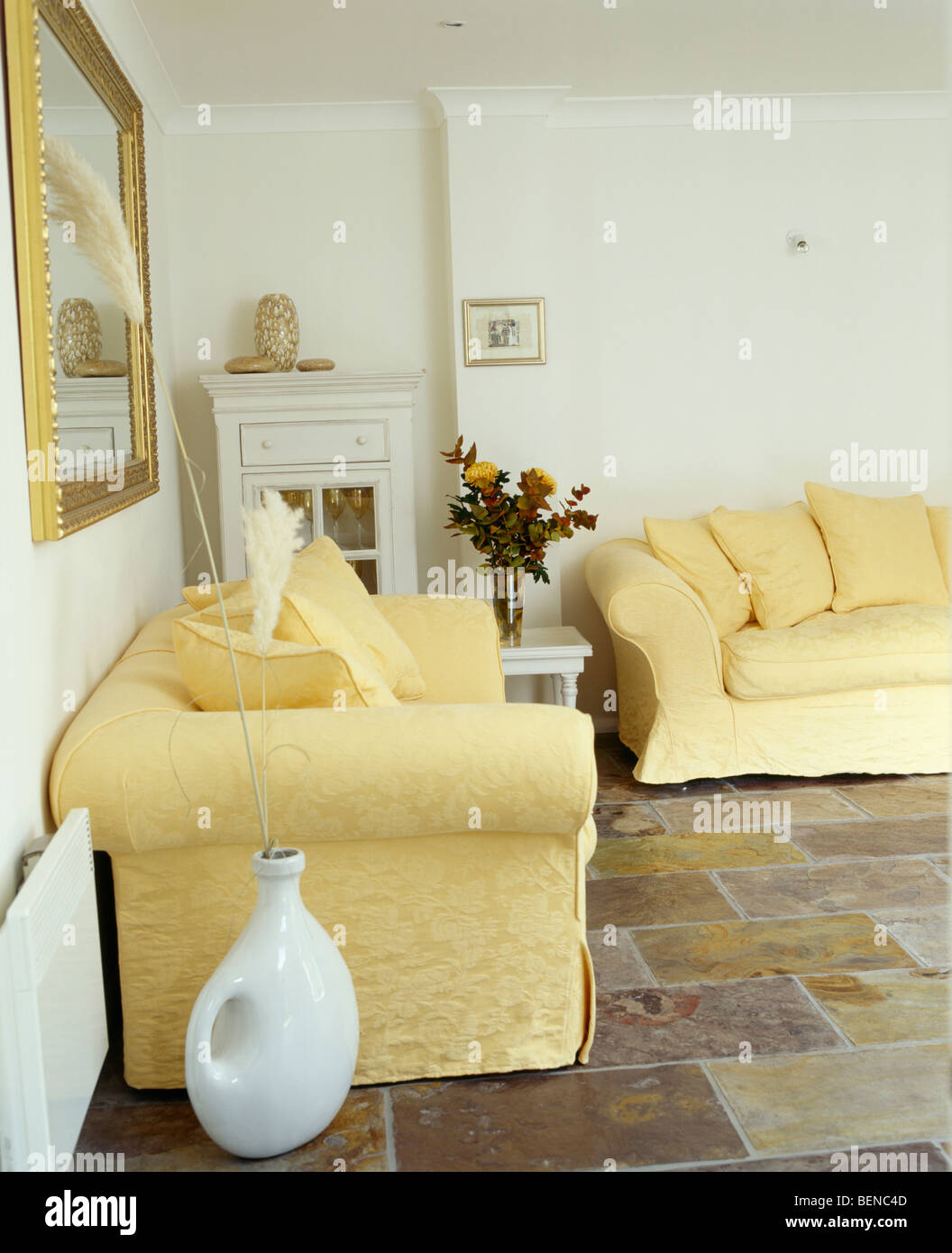 Pale Yellow Sofas Sofas In White Living Room With Slate Floor Tiles