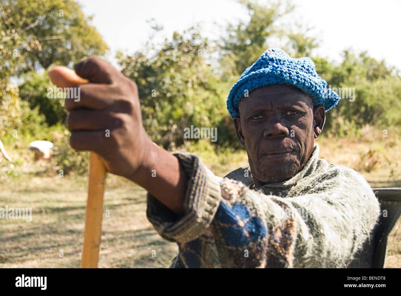 Old man looking strait to the camera, Okavango delta, Botswana, Africa. - Stock Image