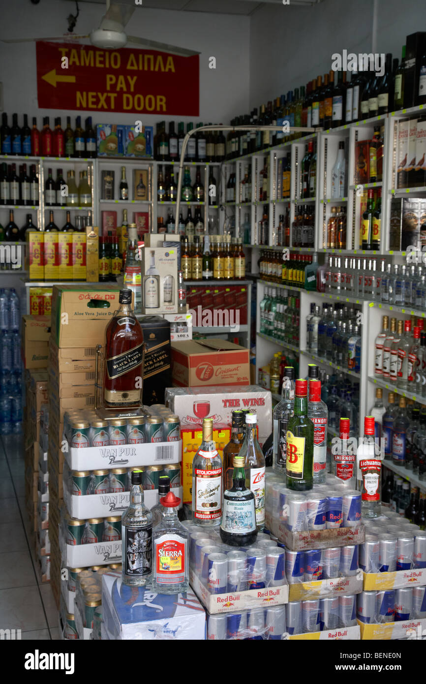 bottles of alcohol in a cypriot off licence larnaca republic of cyprus - Stock Image