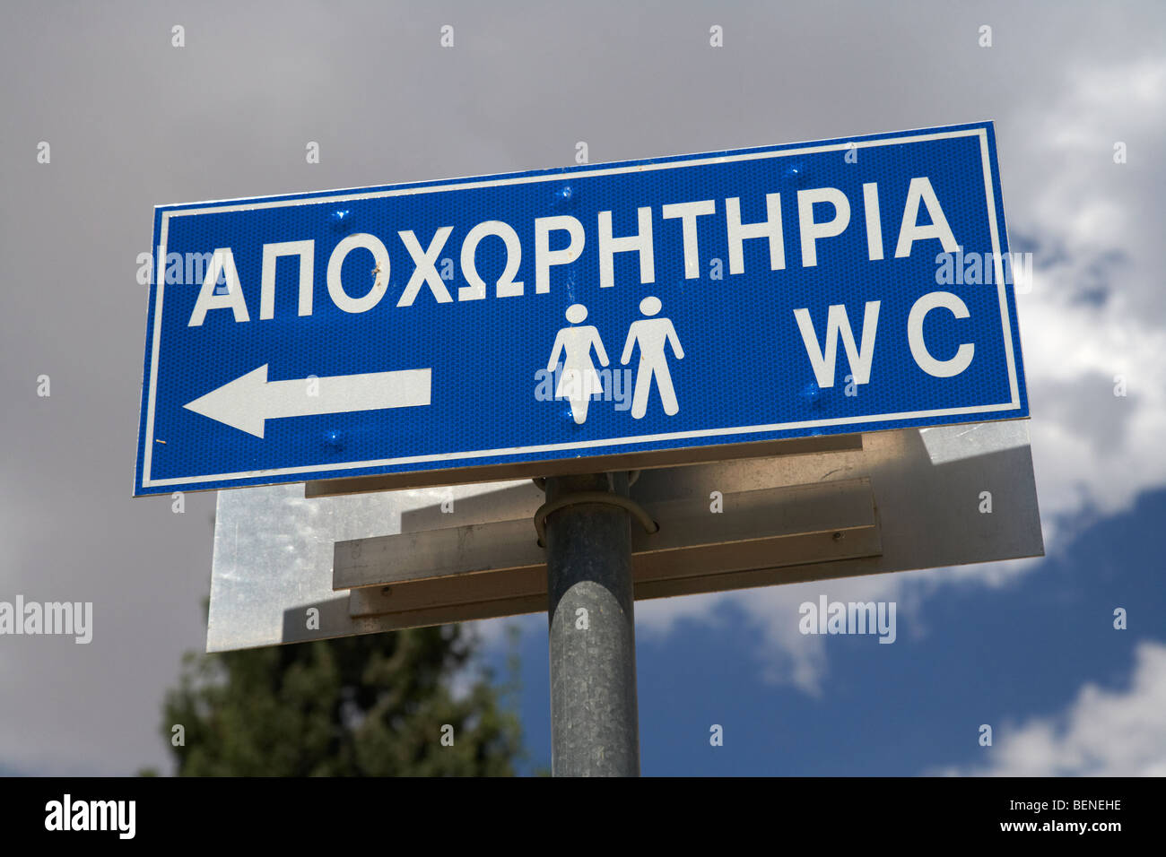 greek language bilingual wc public toilet sign in larnaca in the republic of cyprus - Stock Image