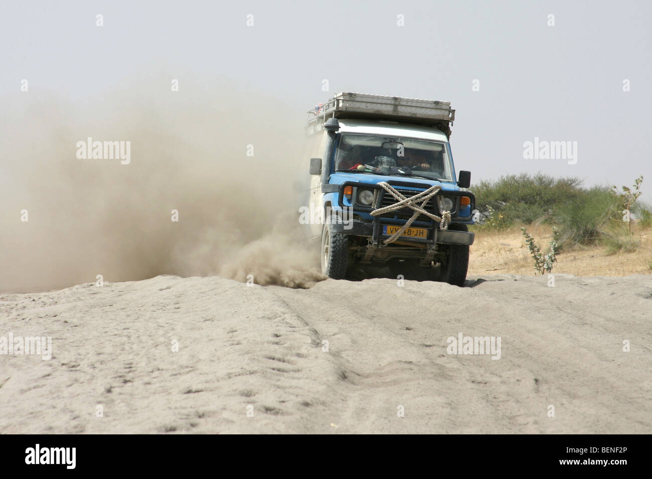 Off-road four-wheel drive vehicle driving on dirt road around Lake Chad, Central Africa - Stock Image