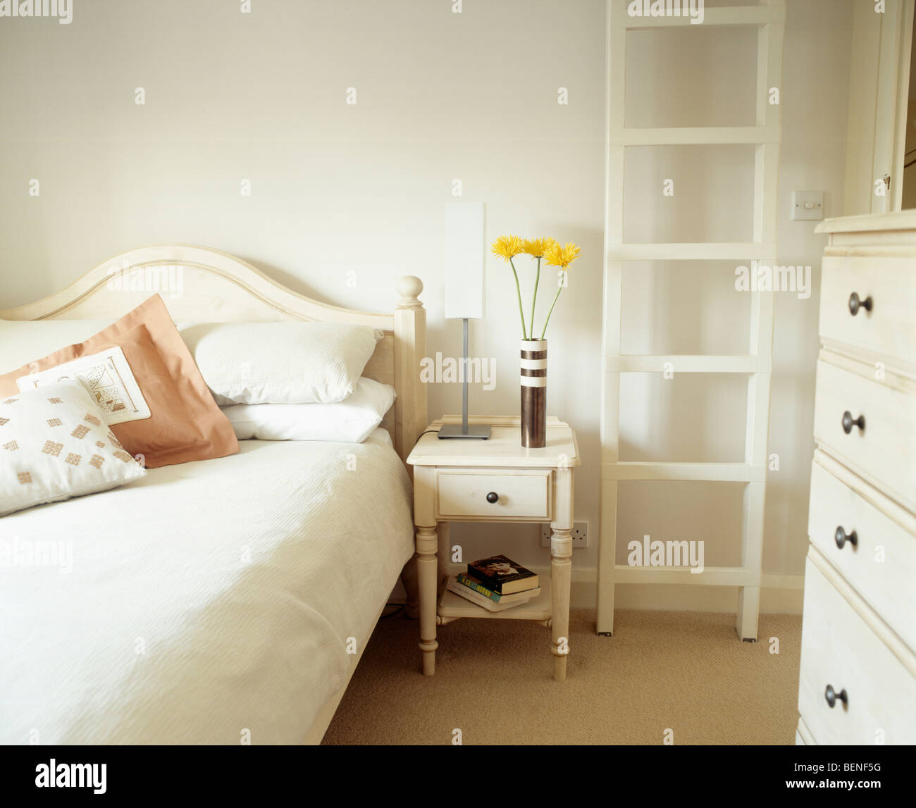 White Ladder And Small White Bedside Table Beside Bed With Cream