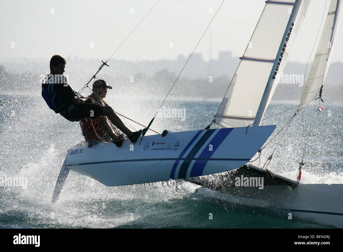 Sailors on a catamaran during the Tanzacat race near Dar es Salaam in Tanzania - Stock Image