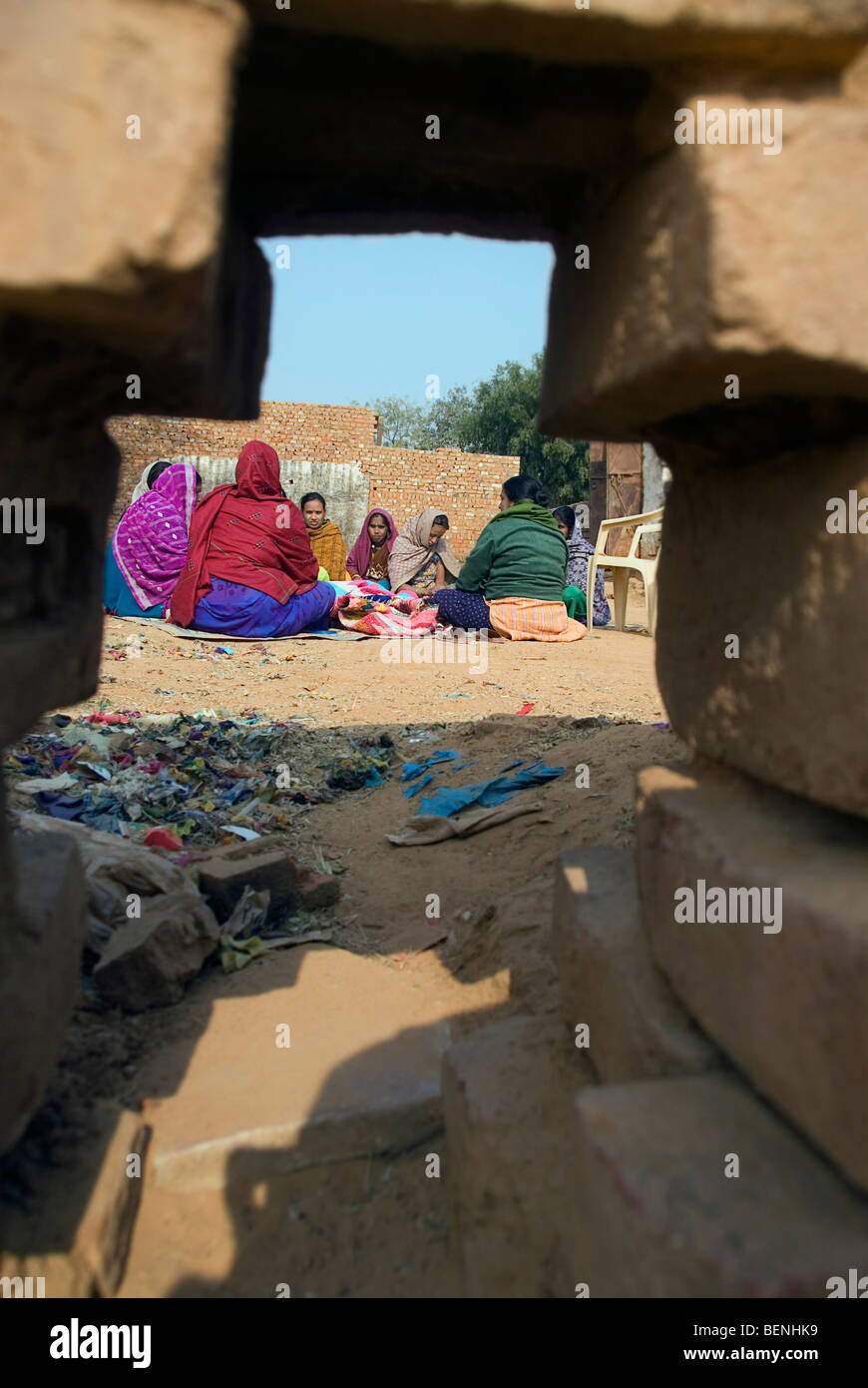 View of women through a broken wall New Delhi India - Stock Image
