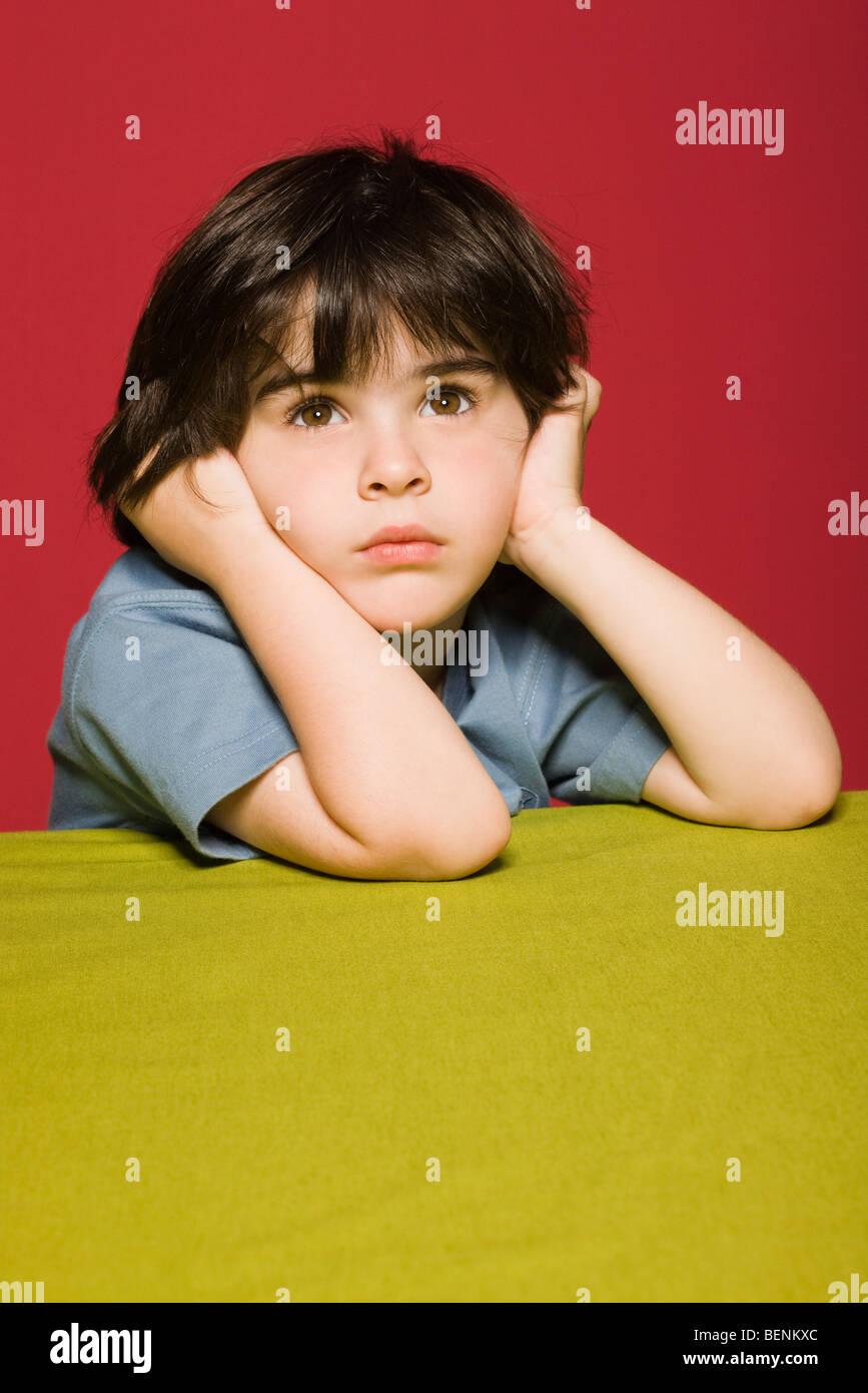 Little boy daydreaming, portrait Stock Photo