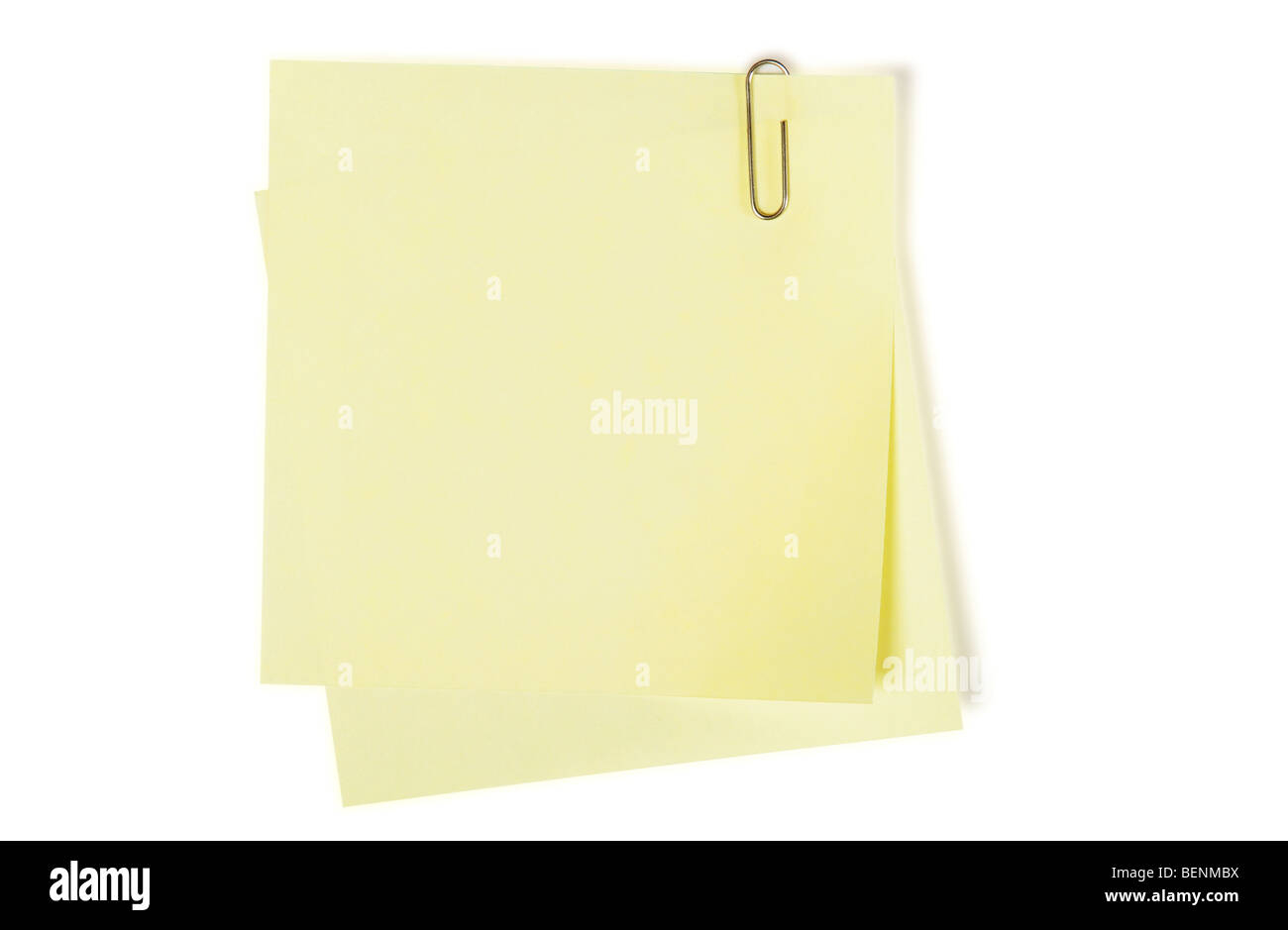Yellow sticker note on white background - Stock Image