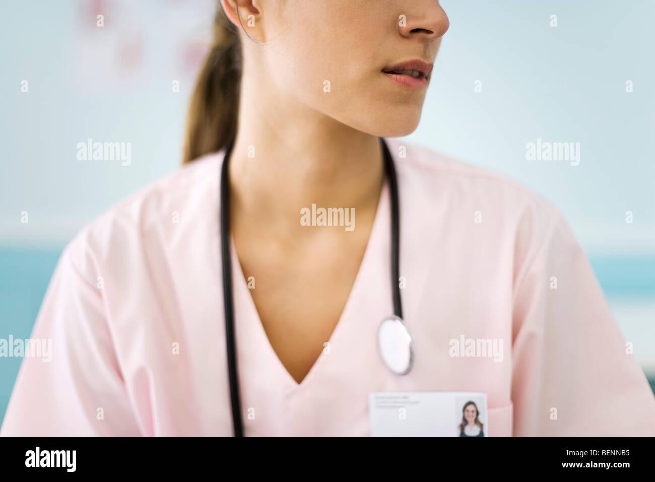 Nurse turning head, cropped - Stock Image