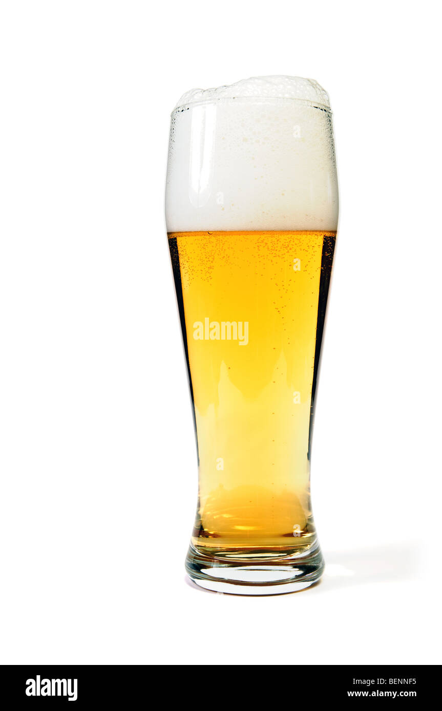 Glass of beer closeup with froth over white background - Stock Image