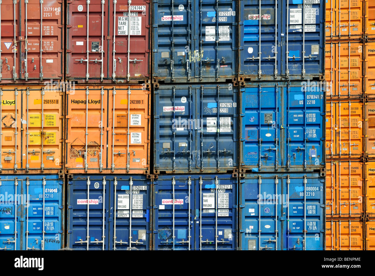 Piled up / Stacked up shipping containers at container terminal in port Stock Photo