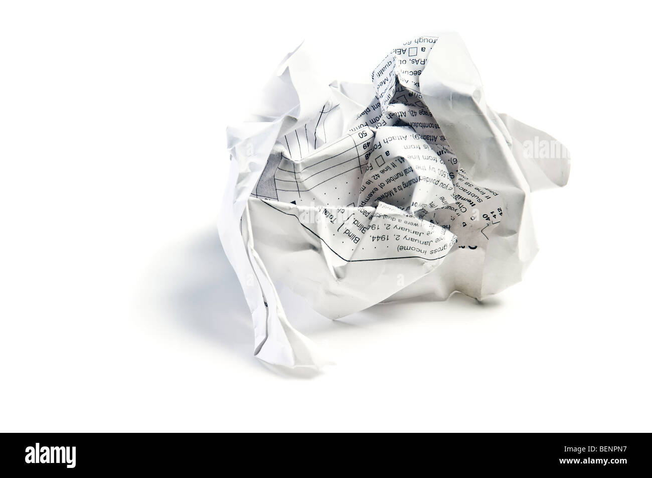 Closeup of a crumpled paper isolated on white background - Stock Image