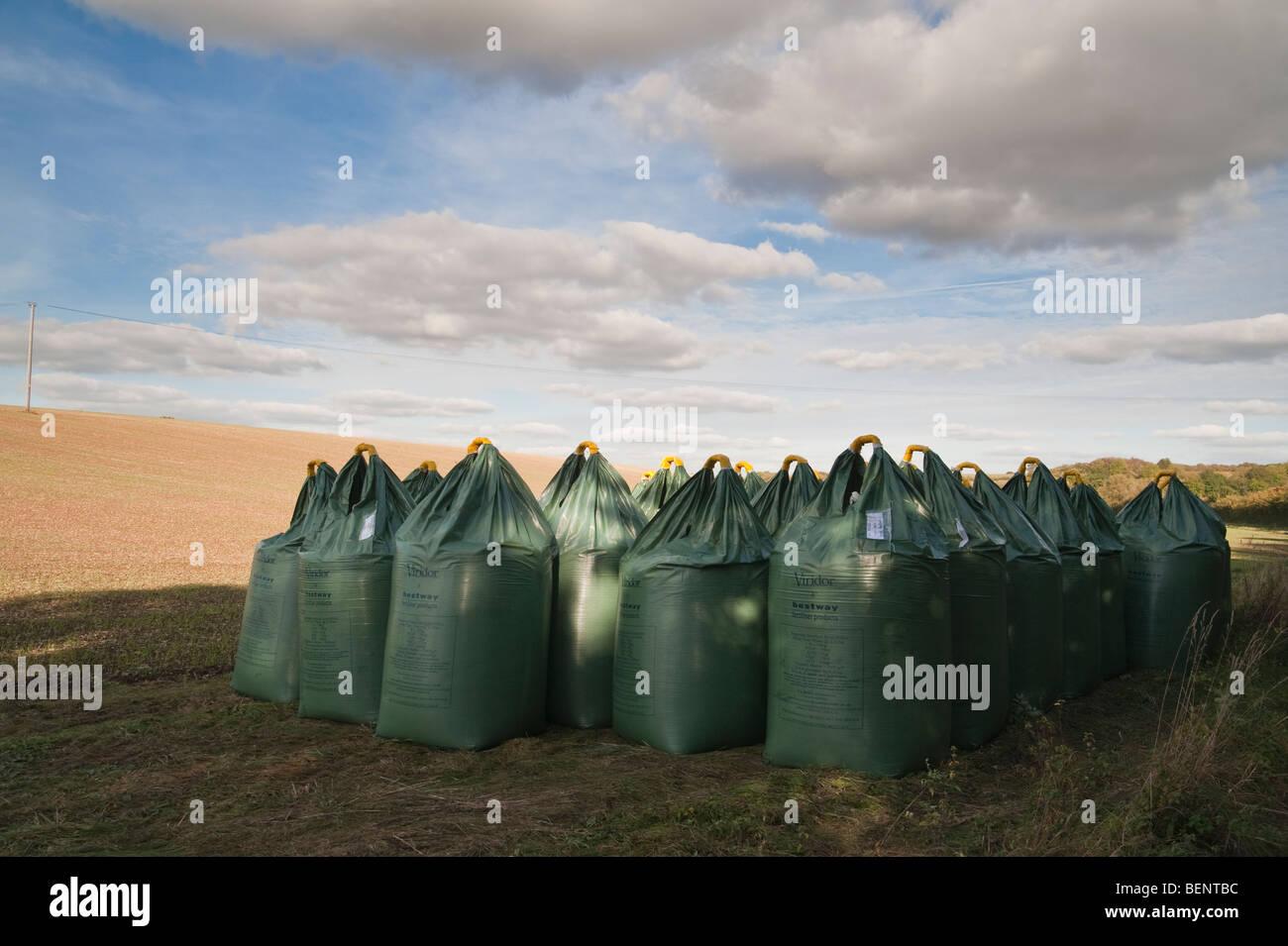 Large chemical fertiliser bags beside a field - Stock Image