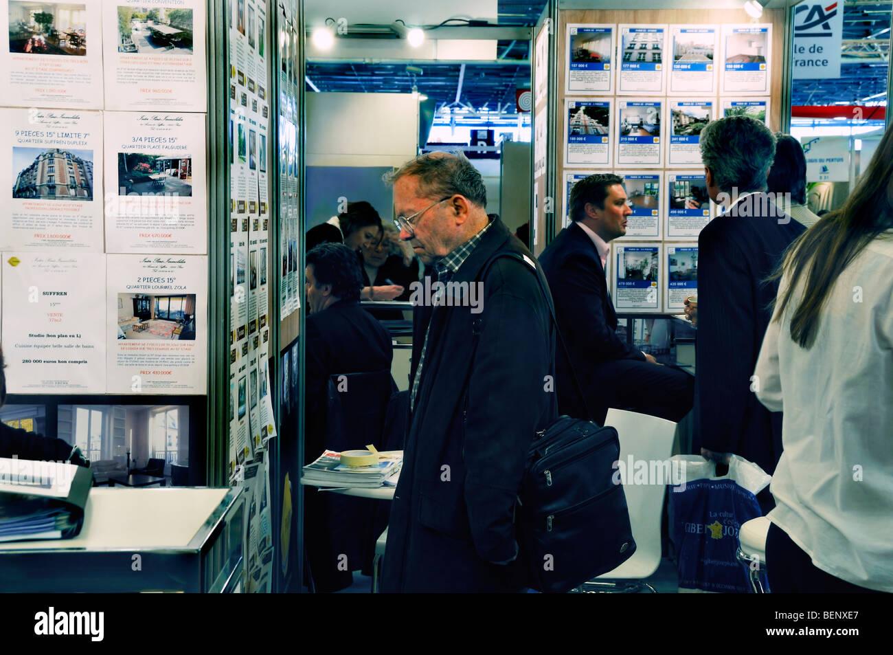 Paris, France - Senior Man Reading House Sales Ads, Interior View of Paris 'Real Estate' Annual Exhibit - Stock Image
