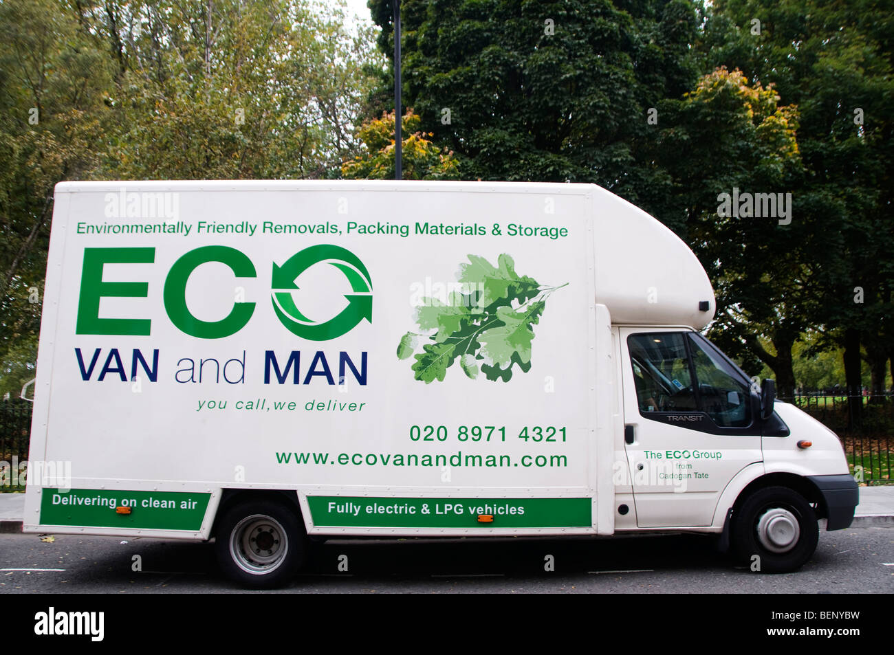 Eco van - environmentally friendly removals van parked in front of a park - Stock Image