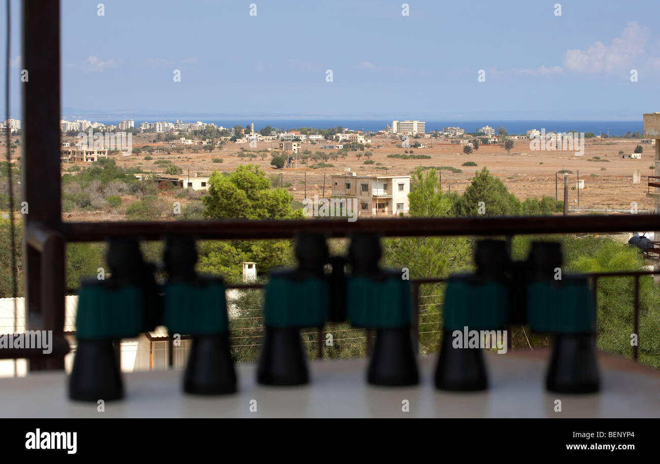 binoculars at observation point for tourists overlooking the UN buffer zone in the green line dividing north and - Stock Image