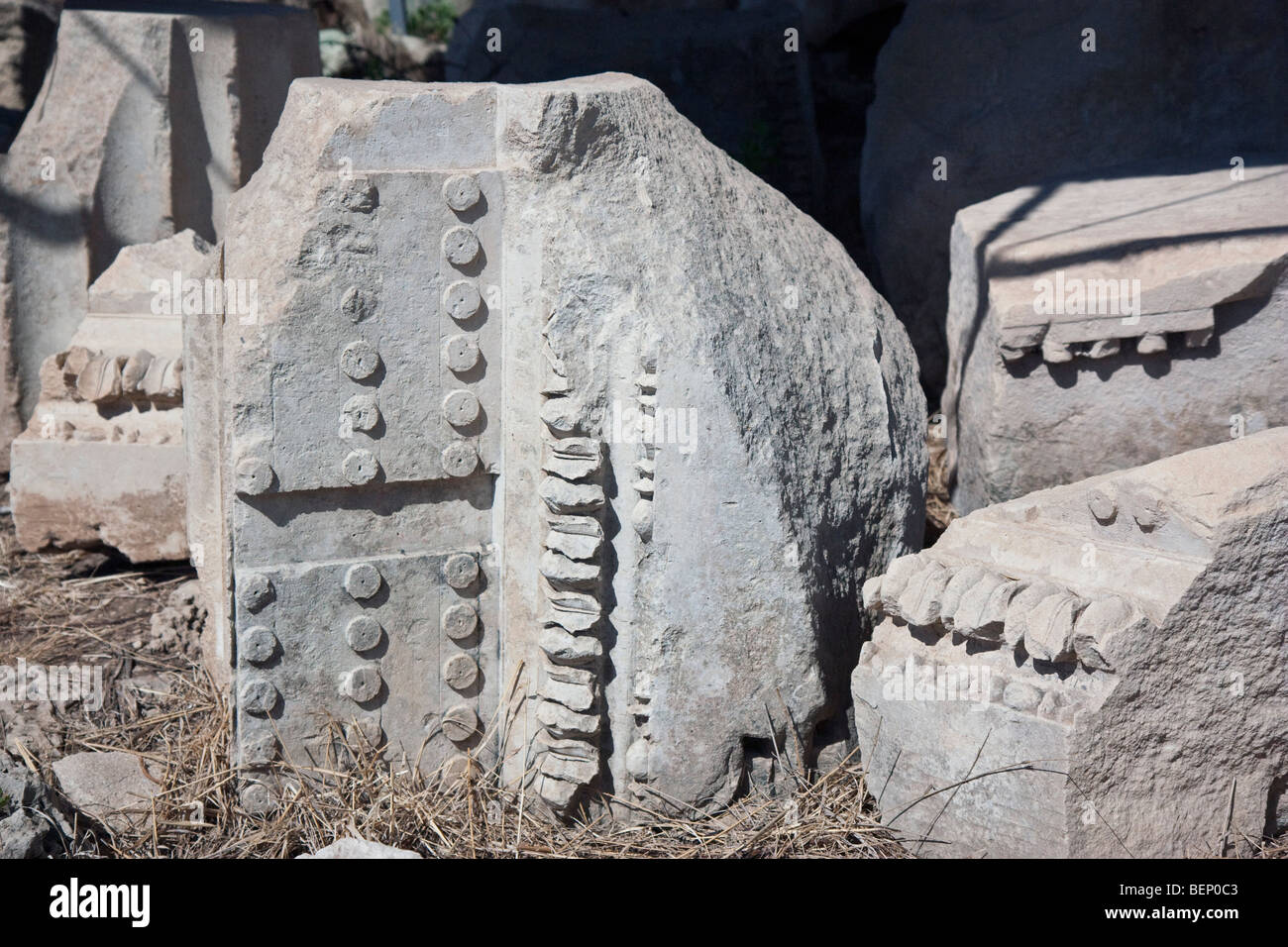 Architectural fragments from the cornice of the fourth-century Doric temple at Megara Hybleia, Sicily. - Stock Image