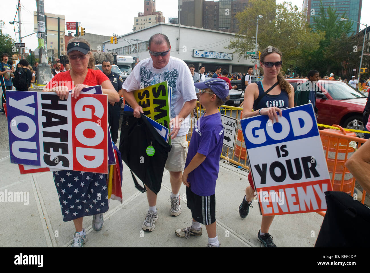 Members of the Westboro Baptist Church pack up their signs after protesting at Brooklyn Technical High School in - Stock Image