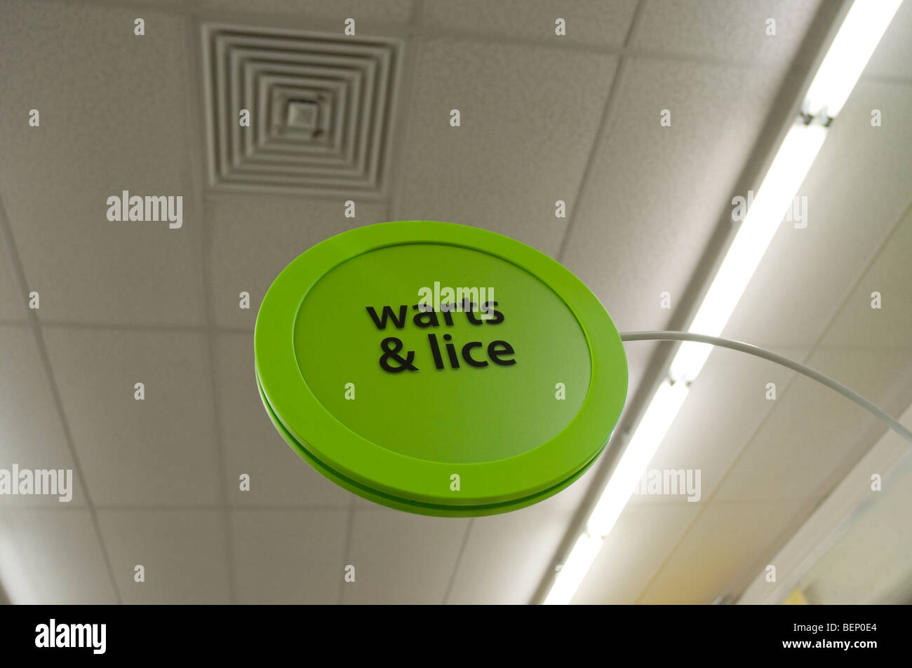 warts and lice sign store pharmacy drug ailments - Stock Image