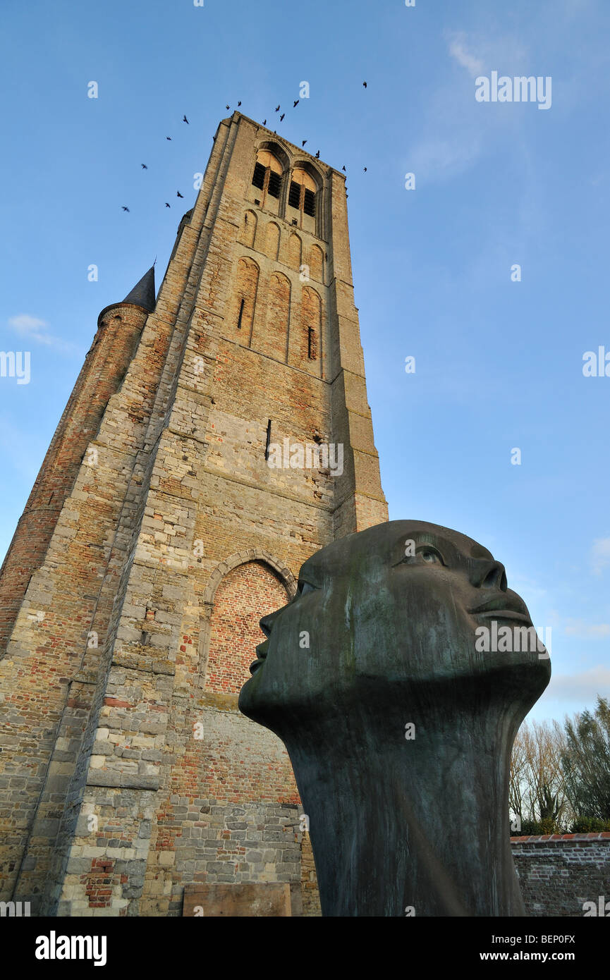 The statue Blik van Licht in front of the Church of Our Lady in the town Damme, West Flanders, Belgium - Stock Image