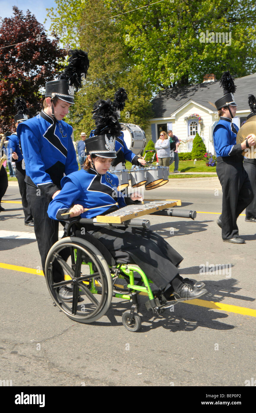 Handicapped Band Member in Parade - Stock Image