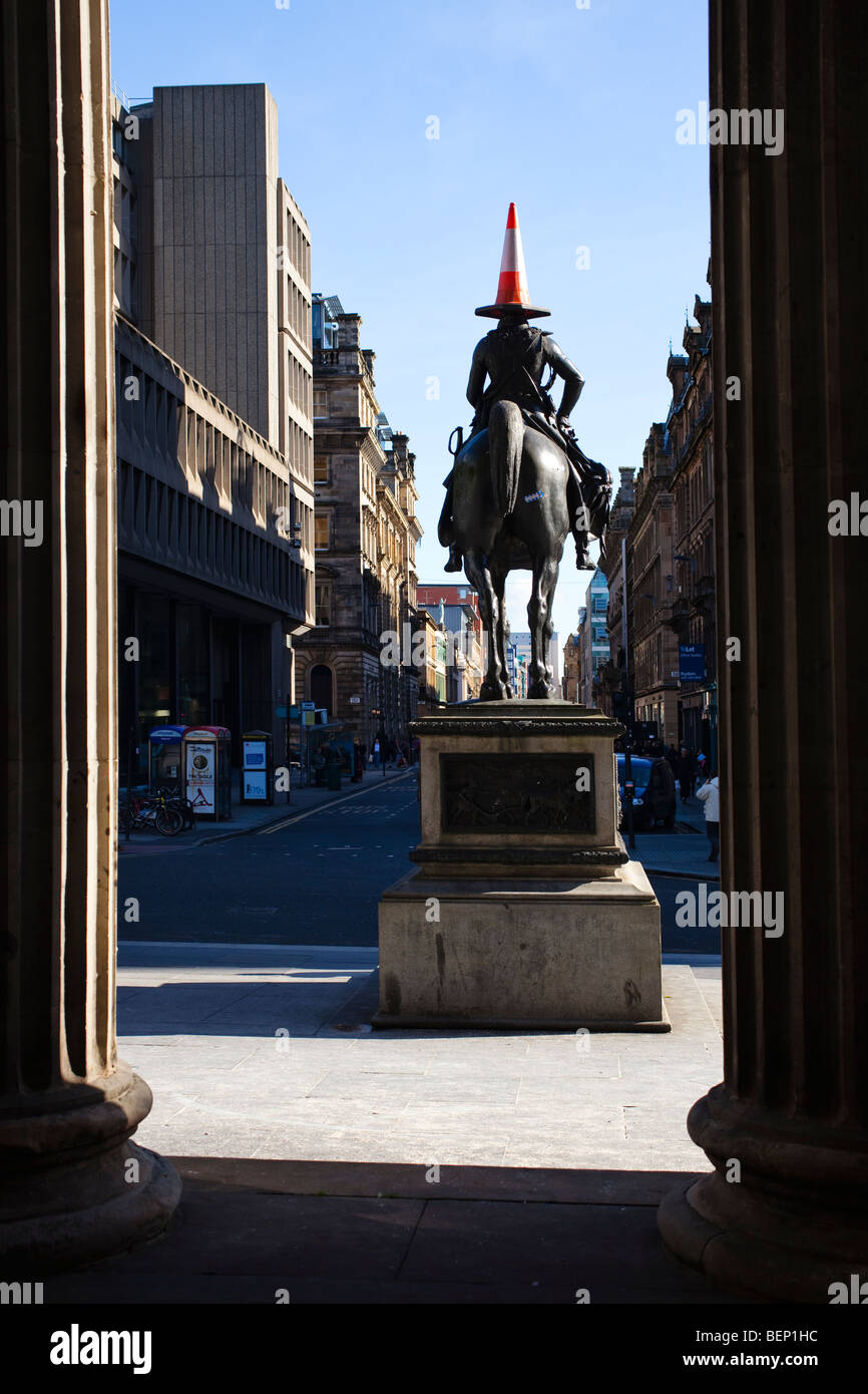 Statue of the Duke of Wellington, with the traditional parking cone on its head, outside the Gallery of Modern Art, - Stock Image