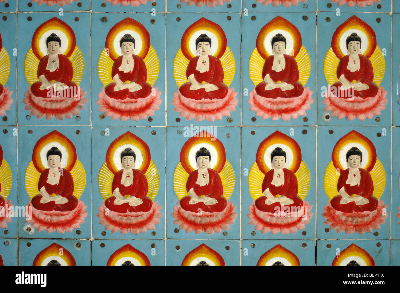 Ten Wall Tiles of Red & Yellow Seated or Sitting Buddhas at Kek Lok Si Chinese Temple Penang Malaysia - Stock Image