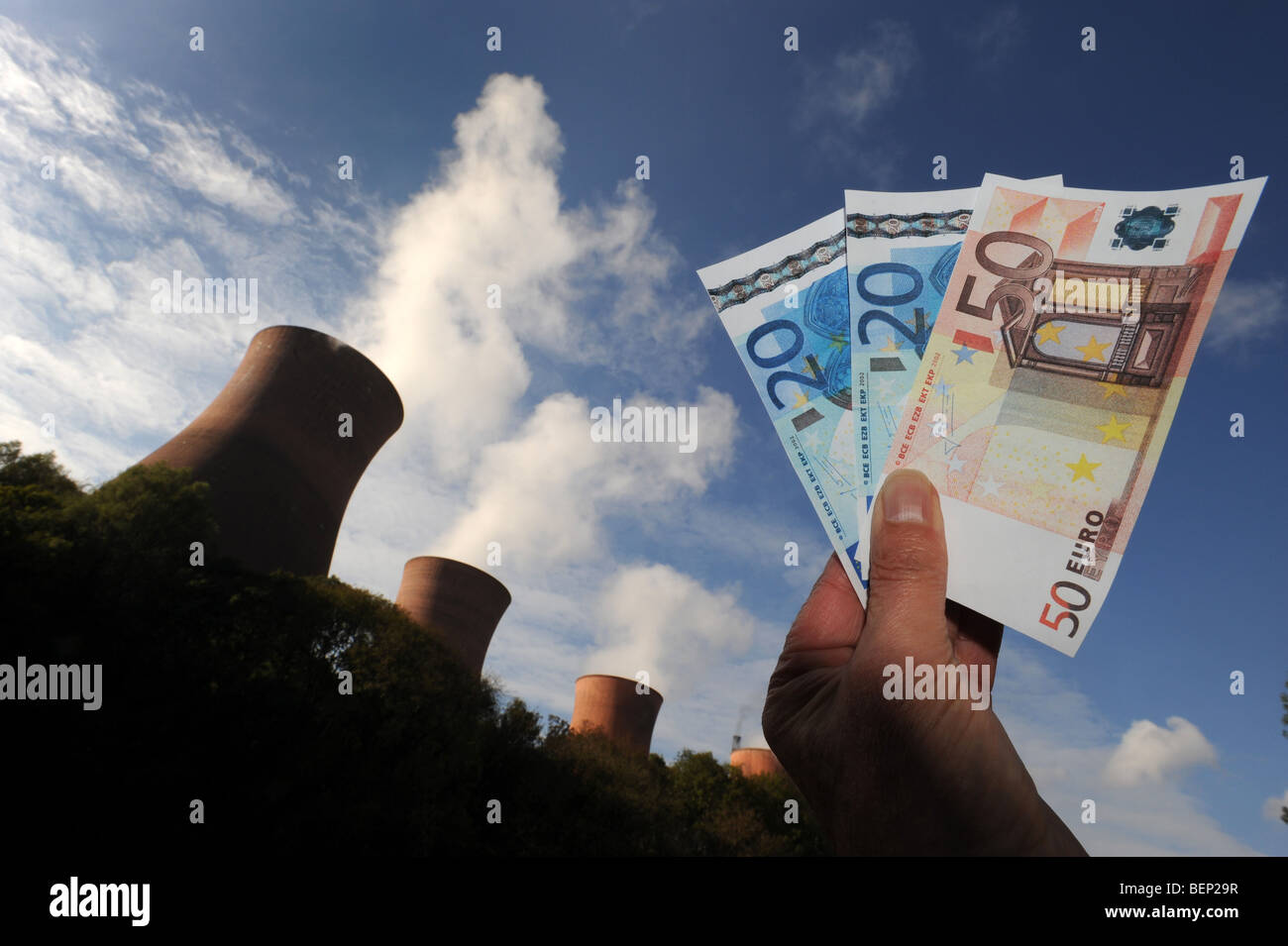 Energy price increases depicted with Euro money and power station Stock Photo