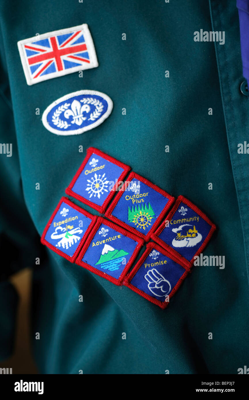 Boy scout with merit badges on the arm of his uniform, UK - Stock Image